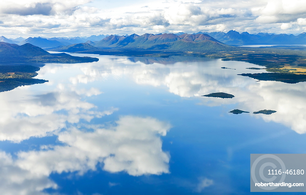 Aerial View Of Clouds Reflecting On The Glassy Surface Of Nerka Lake, The Wood River Mountains In The Background, Wood Tikchik State Park, Southwestern Alaska, Alaska, United States Of America