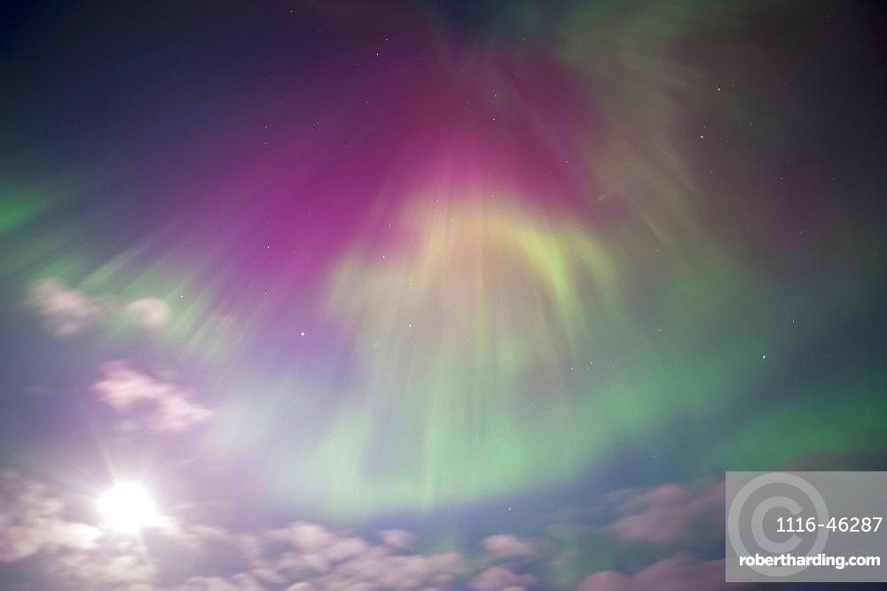 Aurora Borealis Display Over Turnagain Arm Near Girdwood, Alaska, With Full Moon, Alaska, United States Of America