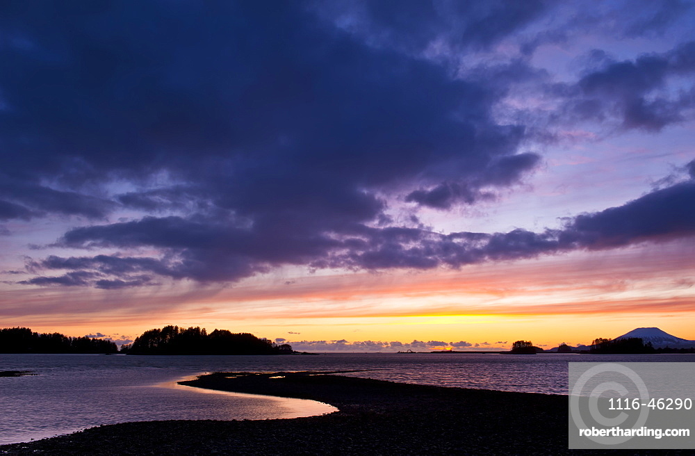 Dramatic Sky At Sunset Over The Ocean And Silhouetted Coastline, Sitka, Alaska, United States Of America