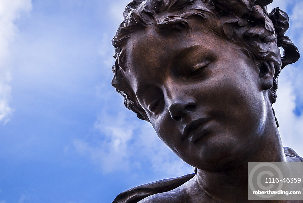 The Beautiful Face Of A Female Statue Made Of Bronze, Paris, France