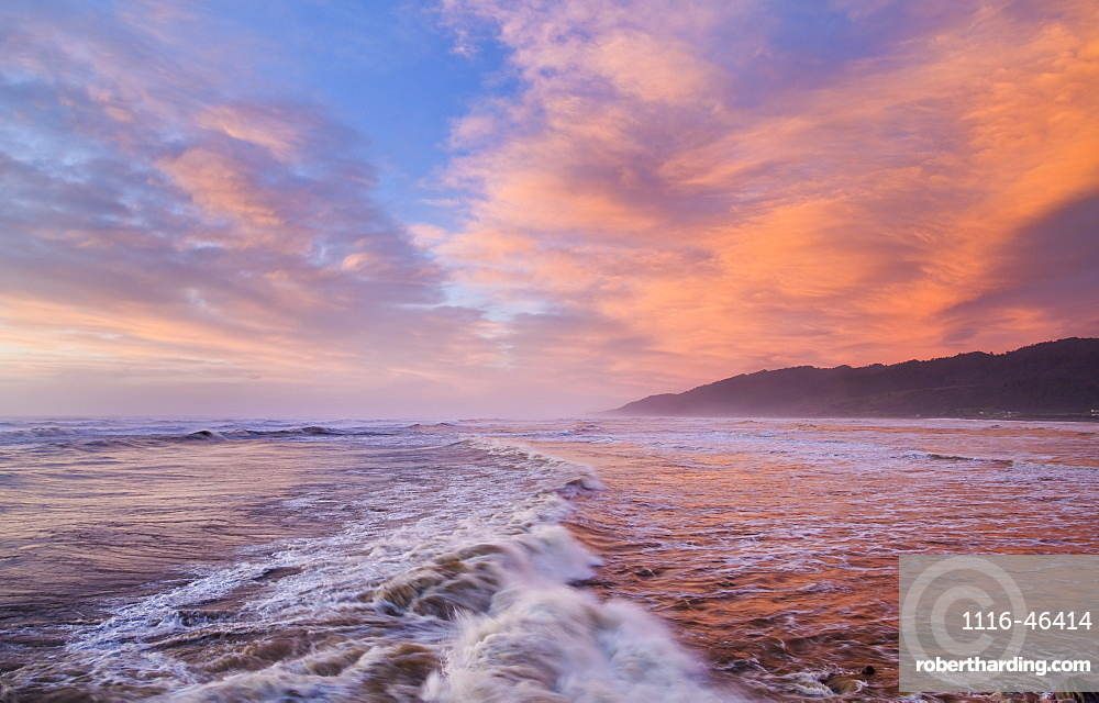 Vibrant Red Sunset Over Cobden Beach And Waves, Sunset Reflected In The Sea, Greymouth, South Island, New Zealand
