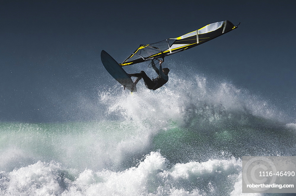 Windsurfer In The Air Above Splashing Waves, Tarifa, Cadiz, Andalusia, Spain