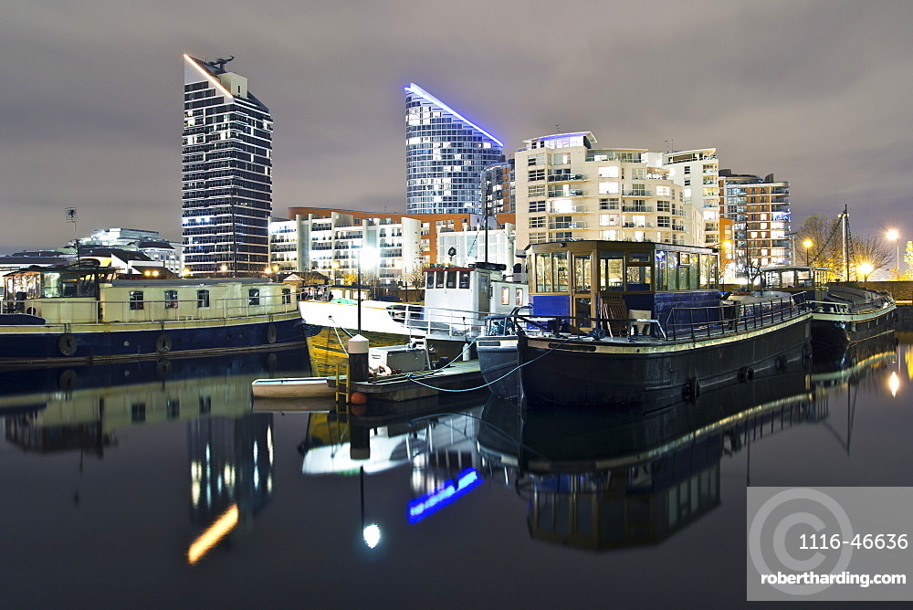 Reflections In Water At Night In Docklands Of London, London, England