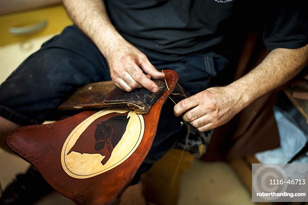 A Craftsman's Hands Working On Leather, Pelotas, Rio Grande Do Sul, Brazil