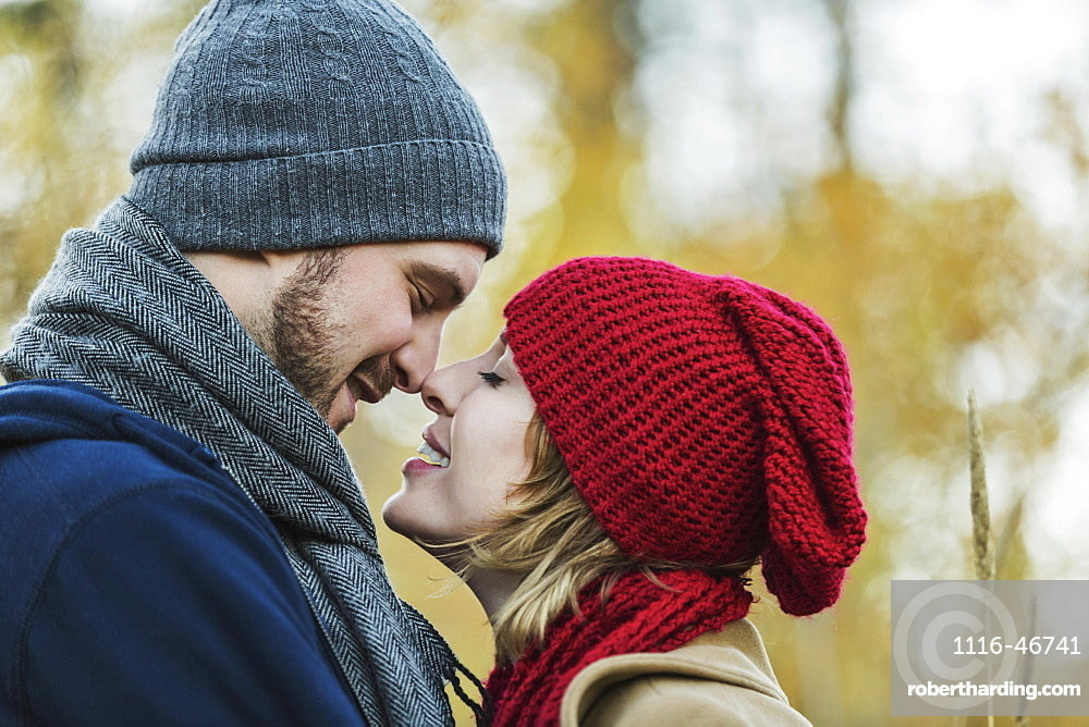 A Young Couple Looking Into Each Other's Eyes And Kissing In A City Park In Autumn, Edmonton, Alberta, Canada