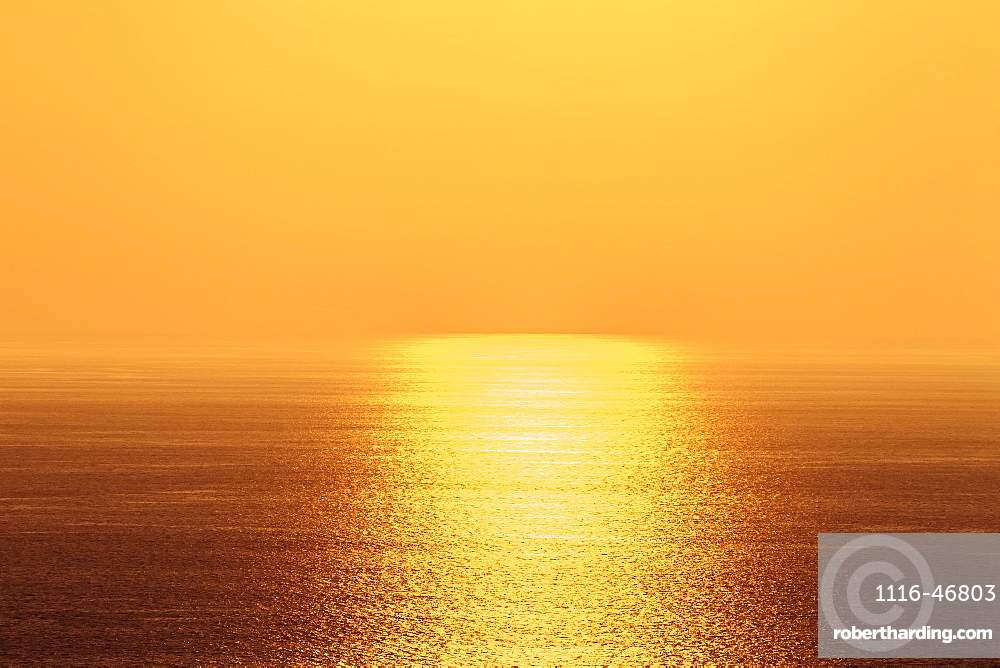 Golden Sky And Sunlight Setting Over The Pacific Ocean, Island Of Hawaii, Hawaii, United States Of America