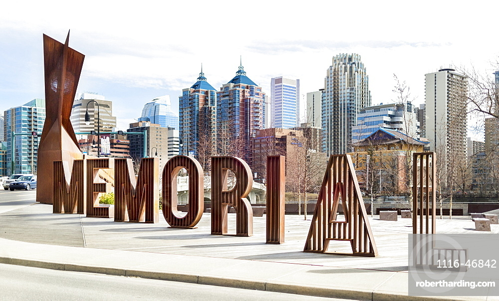 A sign spelled in lettering for Memorial Drive with the Calgary skyline in the background, Calgary, Alberta, Canada