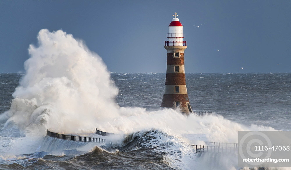 Waves Splashing Against Roker Lighthouse At The End Of A Pier, Sunderland, Tyne And Wear, England