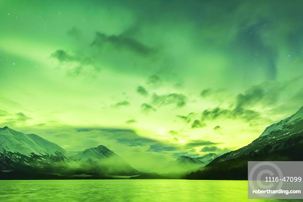 Bright Green Aurora Borealis Dances Over Upper Trail Lake, The Kenai Mountains In The Background, Moose Pass, Kenai Peninsula, South-Central Alaska, Alaska, United States Of America
