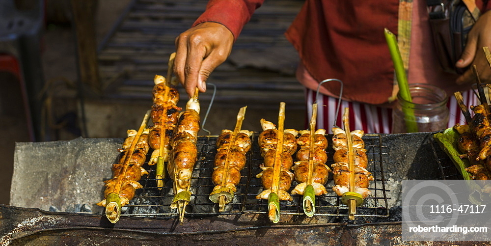 A Hand Turns Skewers On A Grill, Preah Dak, Siem Reap Province, Cambodia