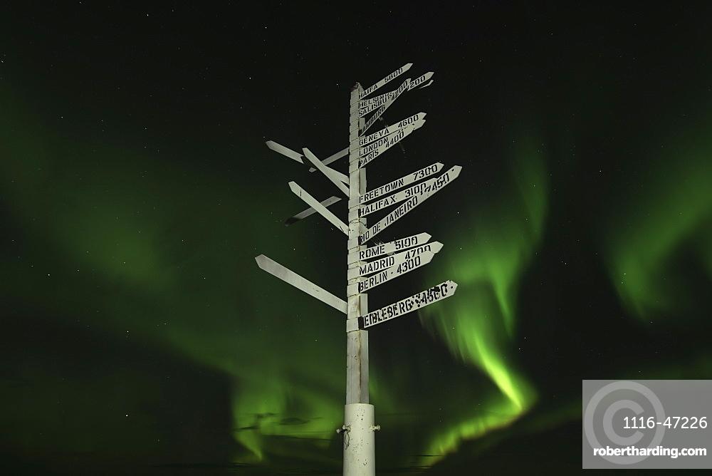 Aurora Borealis In The Sky Above The Signpost On Top Of Keno Hill, Keno, Yukon, Canada