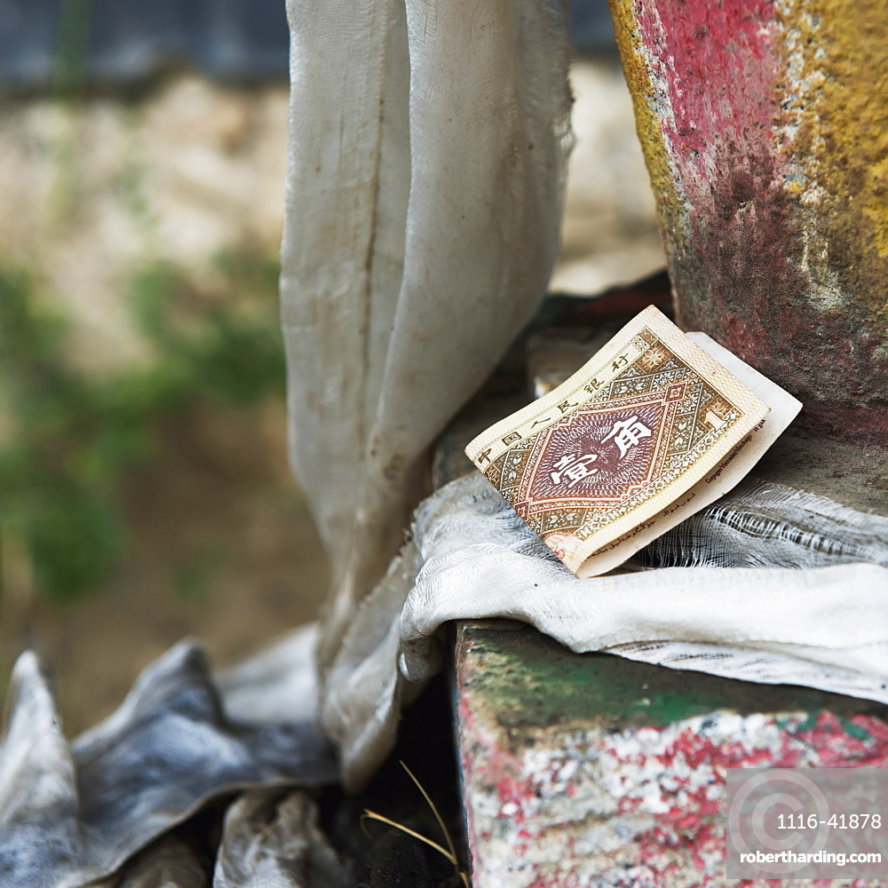 Currency sitting on a step at the drepung monastery, Lhasa xizang china