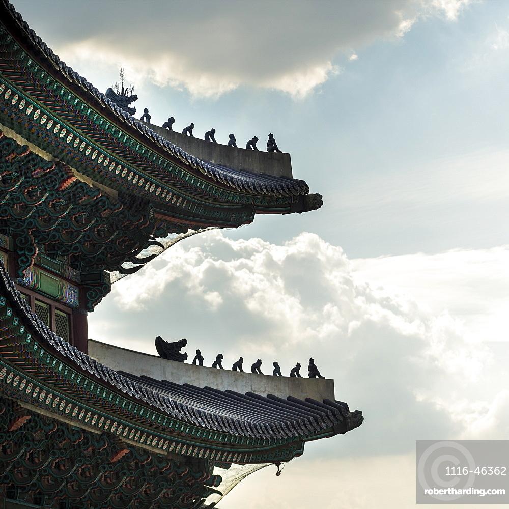 Detailed Roofline Of Gyeongbokgung Palace Against A Blue Sky With Cloud, Seoul, South Korea