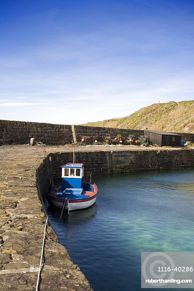 Tugboat Moored To Stone Dock, Scotland