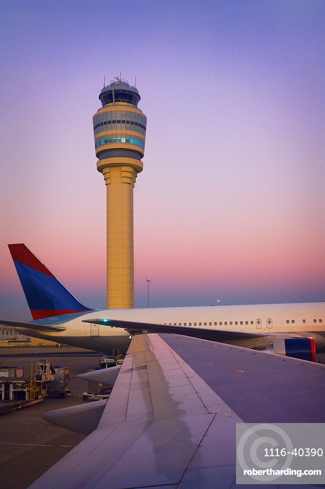 View Of Control Tower Out The Window Of A Commercial Airplane
