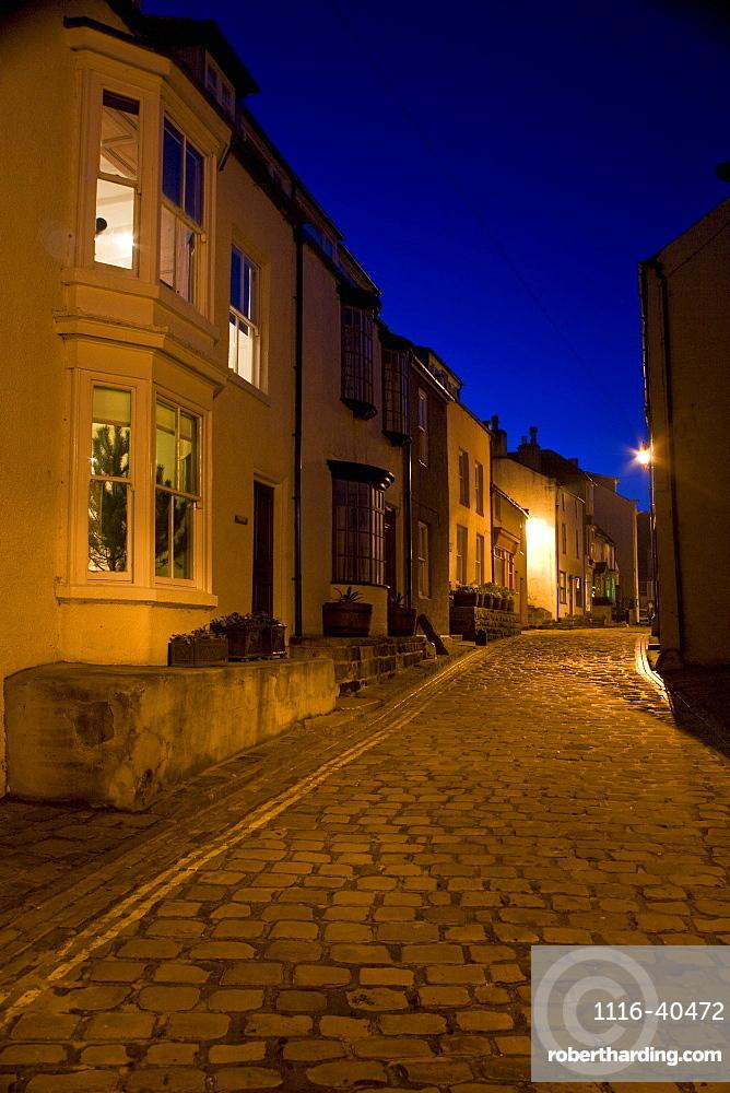 Narrow Cobblestone Road At Night