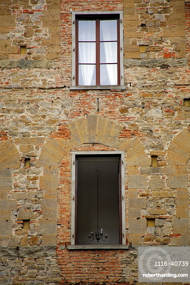 Florence, Italy, Windows On A Brick Building
