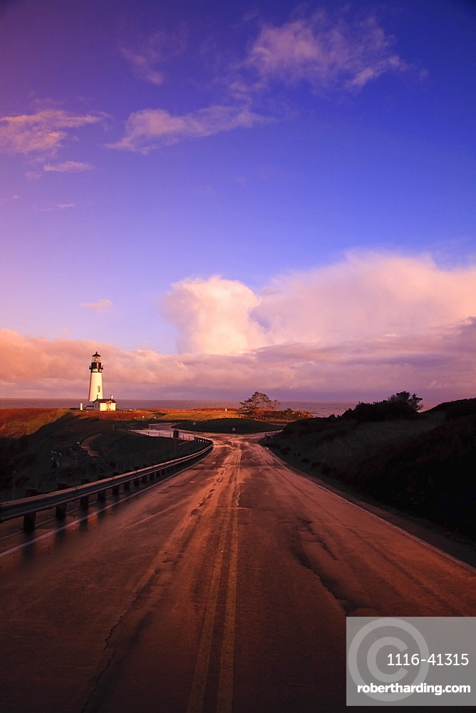 A Road And A Lighthouse Along The Coast