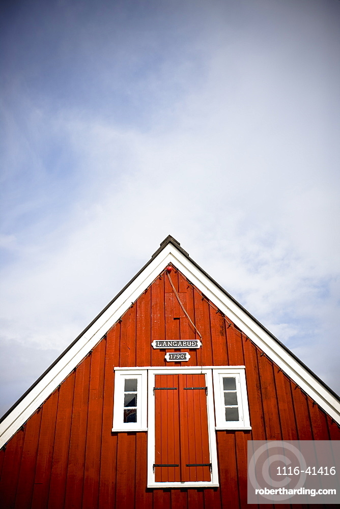 A Red Wooden Building With Shutters On The Window And A Peaked Rooftop, Papey Island, Iceland