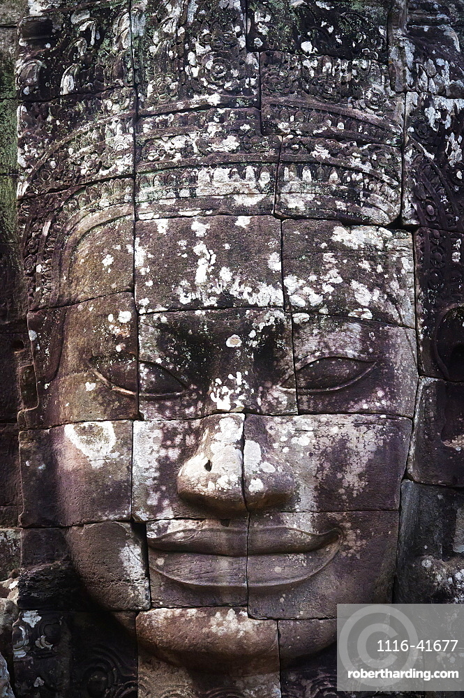 A face sculpture on a stone wall at angkor wat, Cambodia