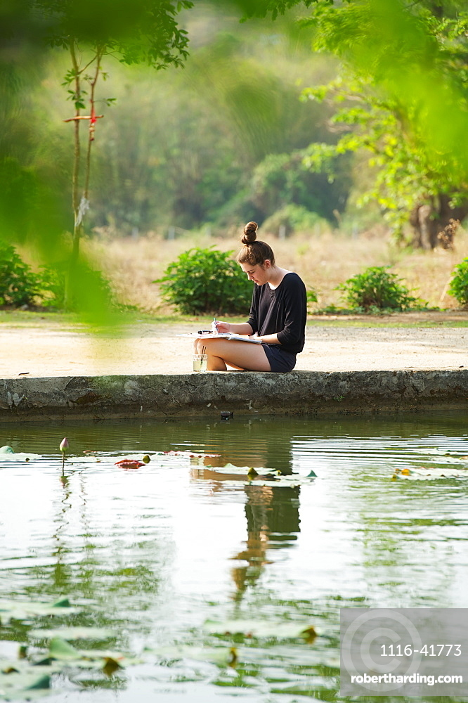 Girl painting beside a lake, Chiang mai thailand