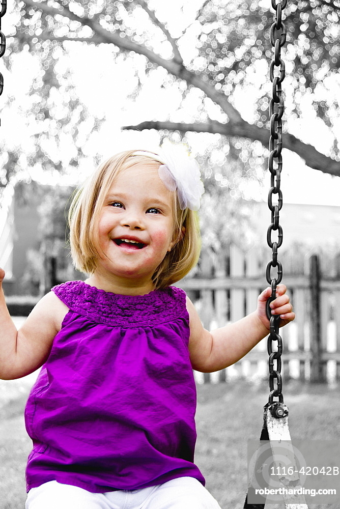 Young Girl With Down Syndrome On A Swing, Three Hills, Alberta, Canada