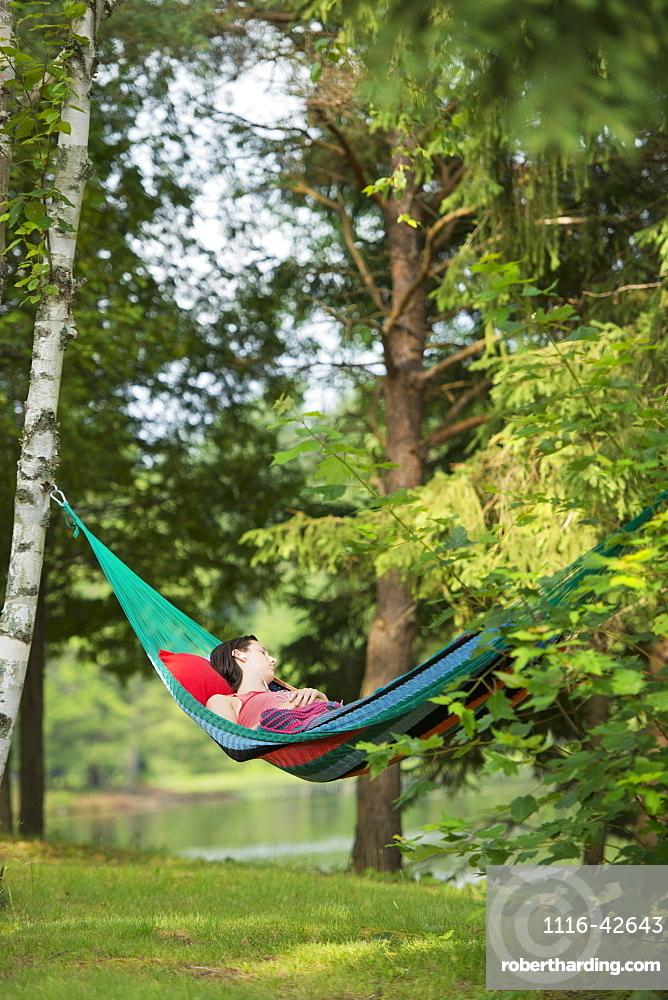 Girl Sleeping In Hammock With Headphones, Ontario, Canada
