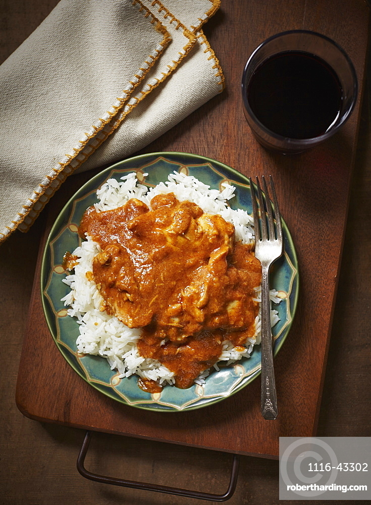 Butter Chicken And Rice On A Plate