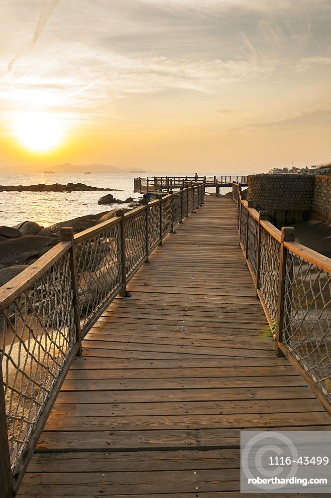 Wooden Boardwalk With Railing Along The Water, Xiamen, Fujian, China