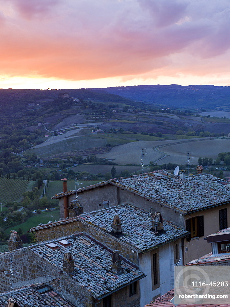 Sunset Over Farmland With Houses In The Foreground, Orvieto, Umbria, Italy