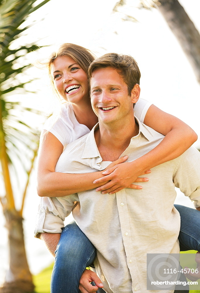 Portrait Of Happy Smiling Young Couple Outdoors