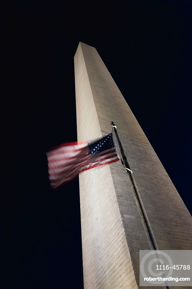 The American Flag Flies In A Stiff Wind At The Washington Monument, Washington, District Of Columbia, United States Of America