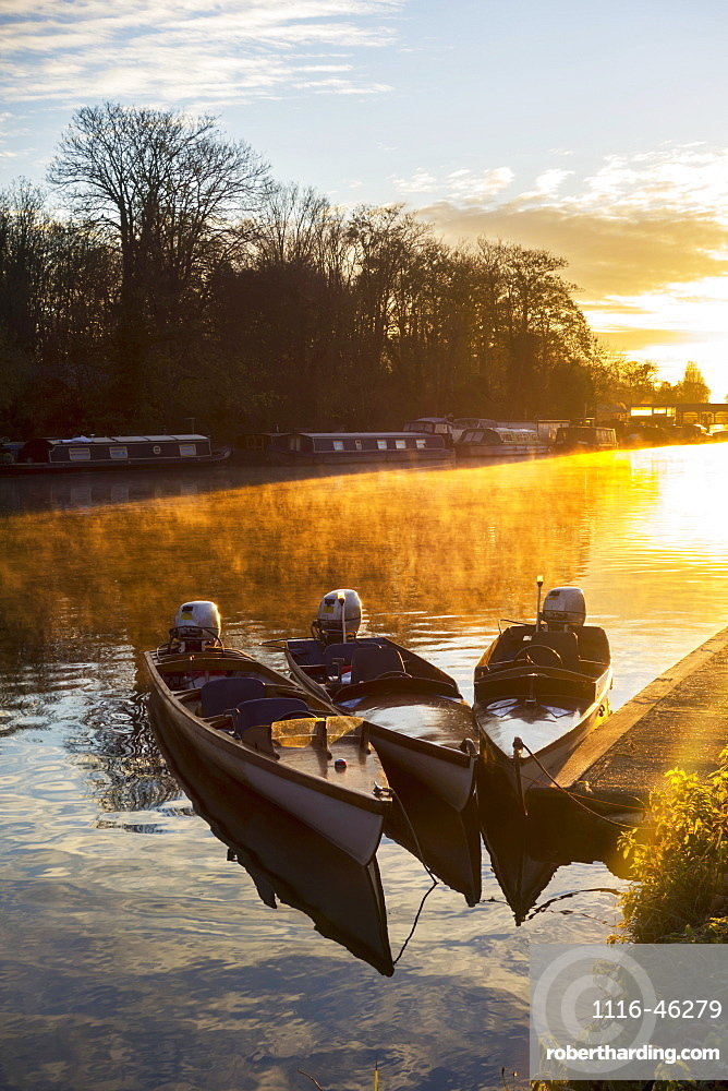 Sunrise Over River Molesey And Small Motorboats Moored Along The Shore, Surrey, England