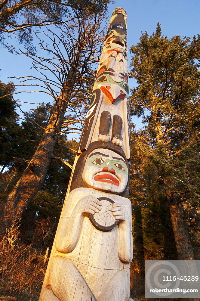 A Totem Dedicated To Japanese Photographer Michio Hoshino Catches Evening Light In The Winter At The Halibut Cove Recreation Area, Sitka, Alaska, United States Of America
