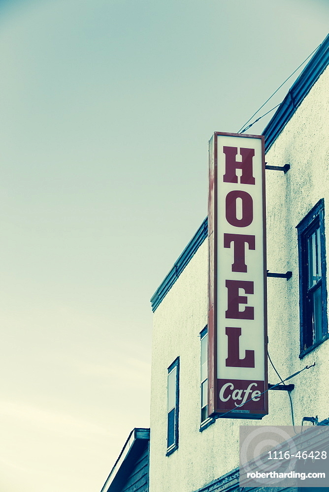 Hotel Sign On The Side Of A Building Against A Blue Sky, Saskatchewan, Canada
