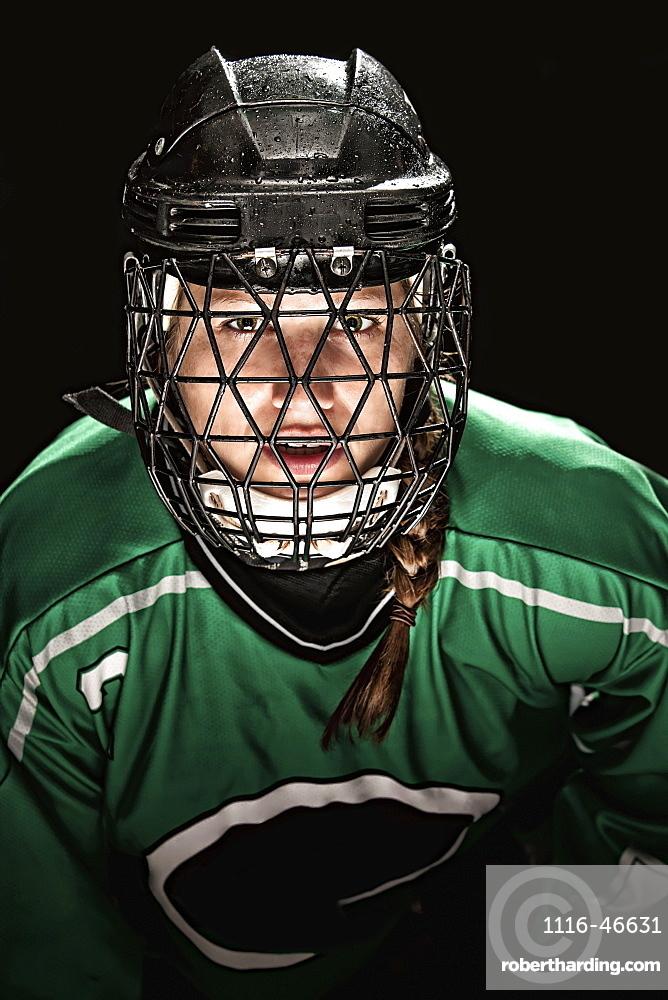 Ringette Player Wearing Green Jersey With Helmet And Cage, Regina, Saskatchewan, Canada