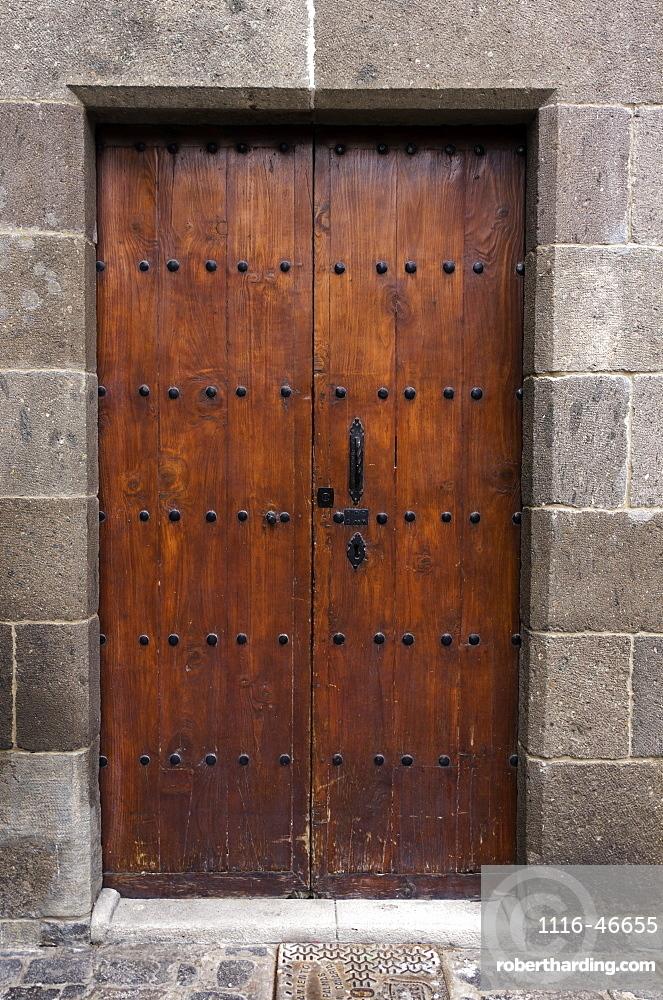 Sixteenth Century Brown Wooden Door, With Iron Fastenings, Set In Stone Doorway, Las Palmas Gran Canaria, Canary Islands, Spain