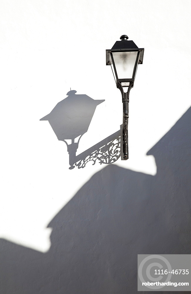 A Light Mounted On A White Wall With Shadows Cast, Conil De La Frontera, Andalusia, Spain