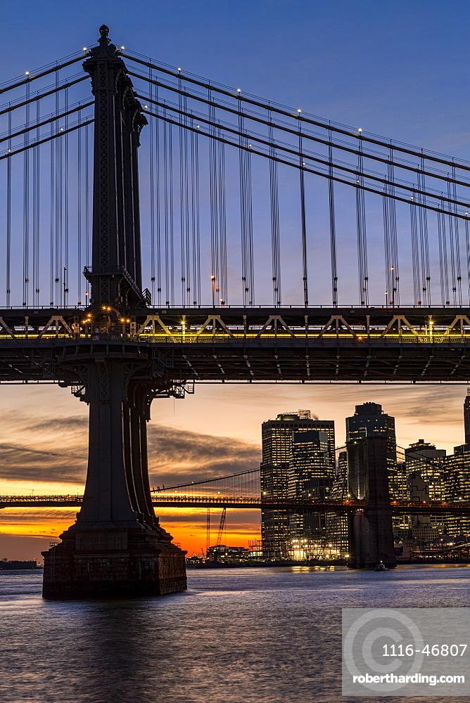 Sunset Behind Manhattan And Brooklyn Bridges, New York City, New York, United States Of America