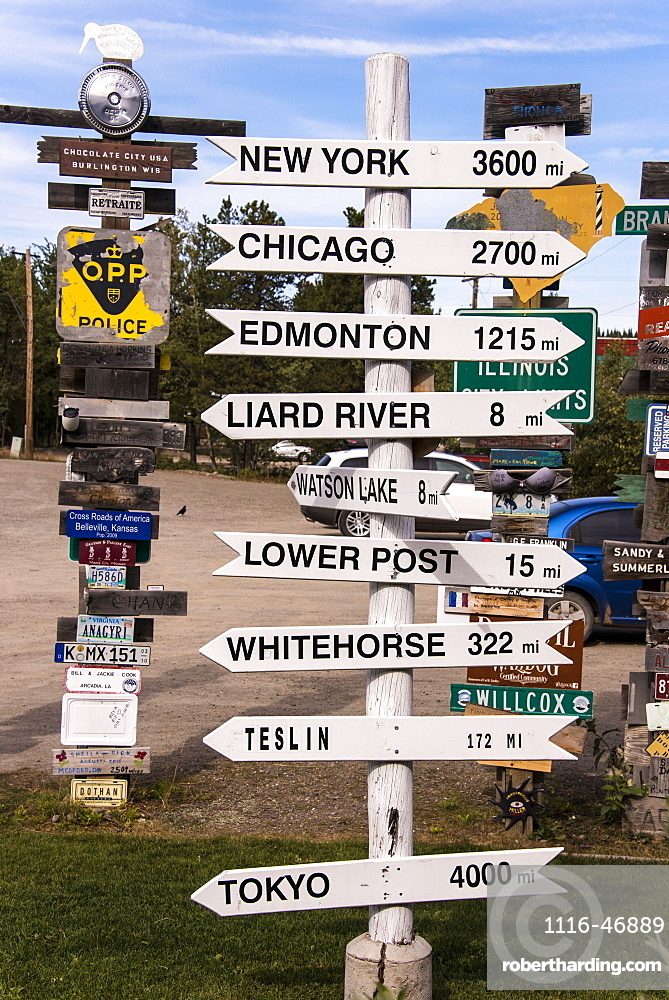 Signpost forest displaying numerous destination and distance signs, Watson Lake, Yukon, Canada