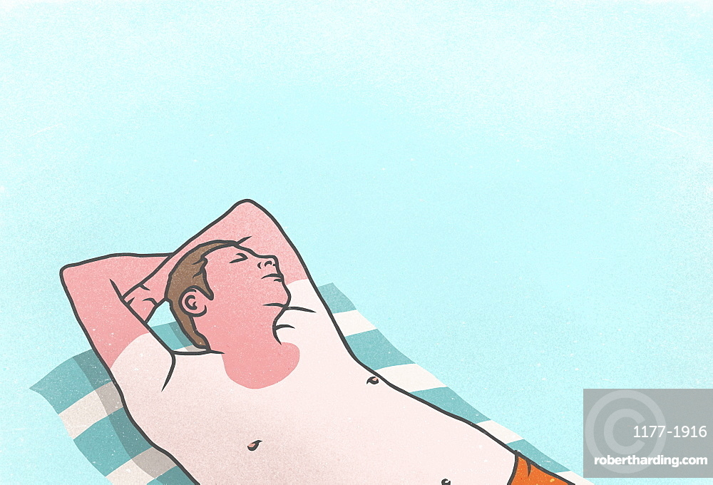 Sunburned man sleeping on towel