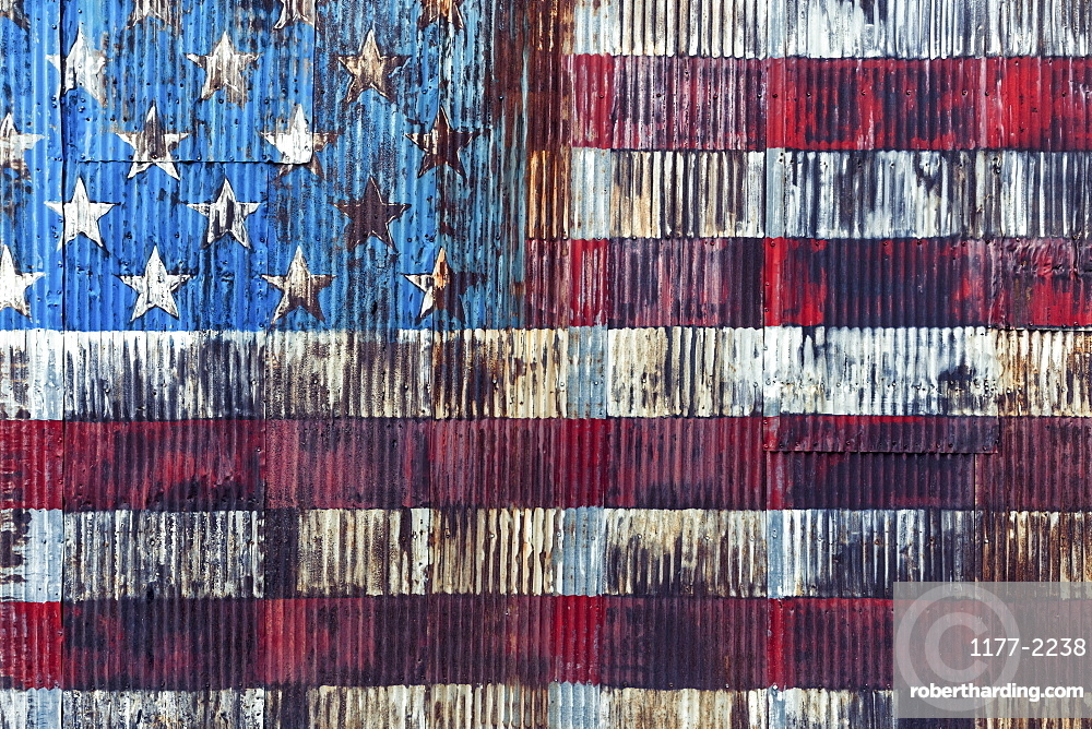 Vintage, rusted American flag painted on corrugated wall