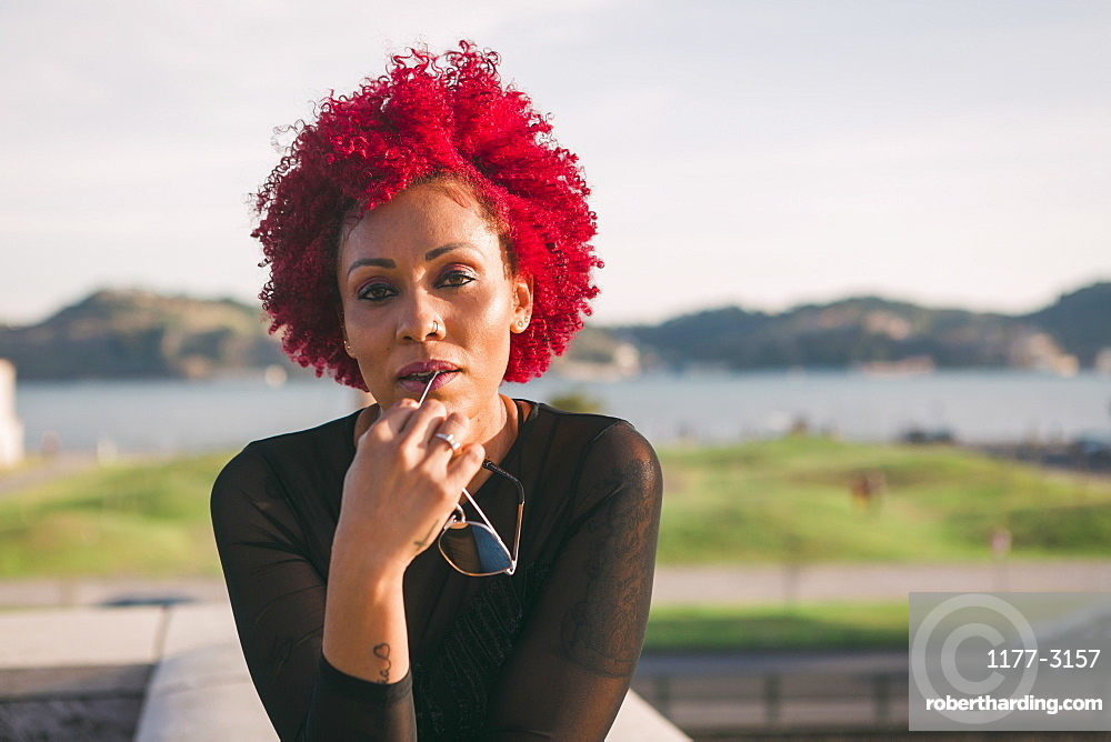 Portrait confident, serious woman with red hair