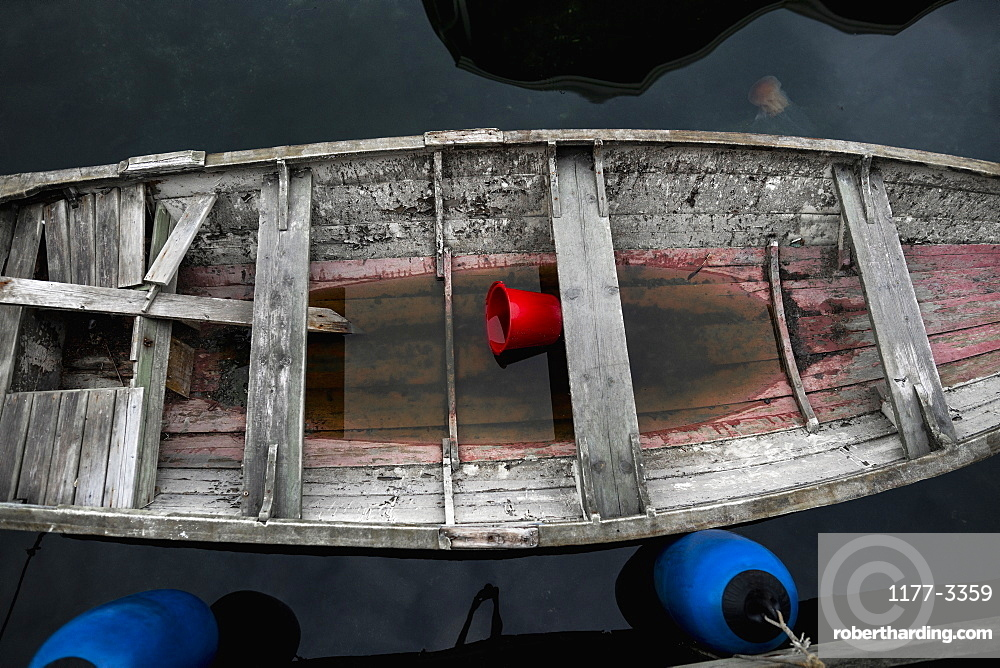 Water inside rotting rowboat