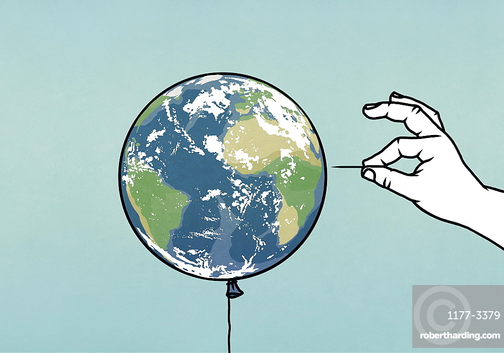 Hand with pin next to globe balloon