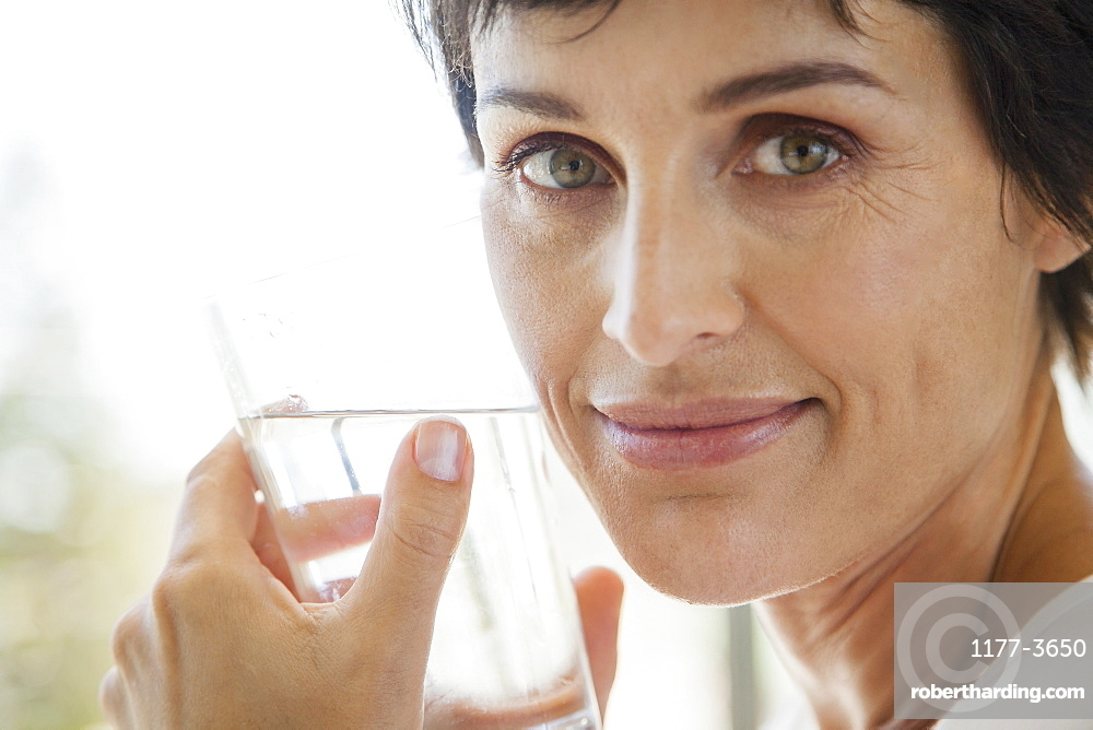 Close up portrait woman drinking water