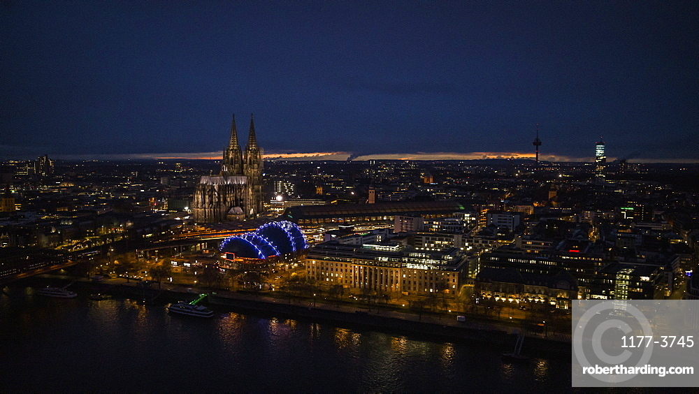 Illuminated Cologne Cathedral and cityscape at night, Germany