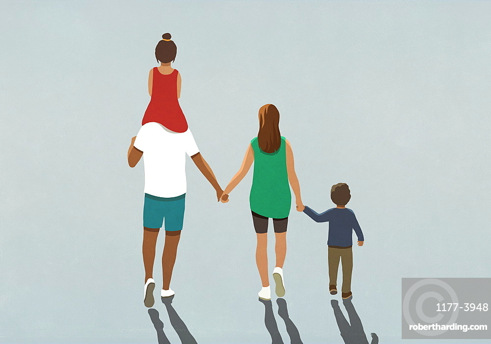 Affectionate family holding hands and walking