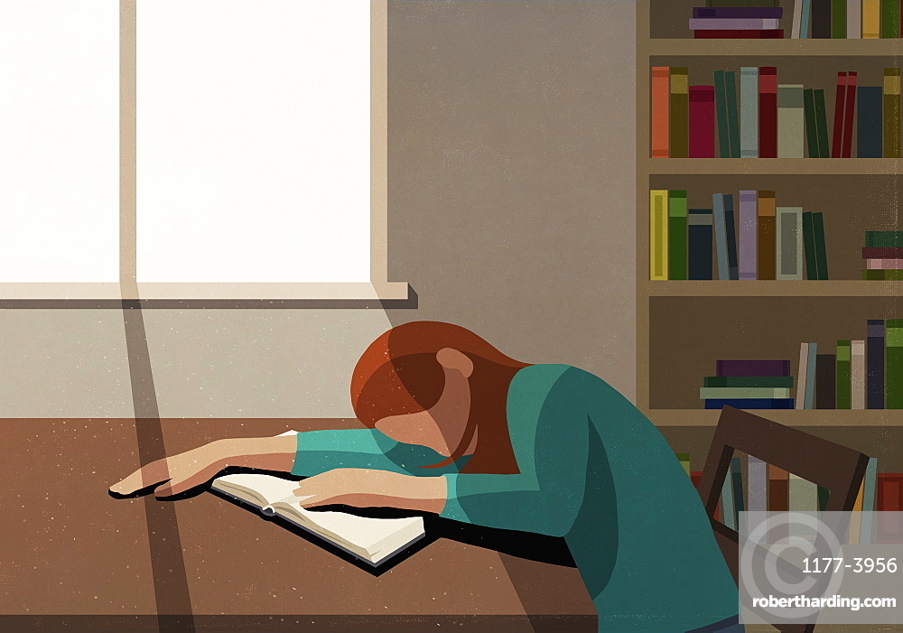 Tired college student sleeping on book at sunny table in library
