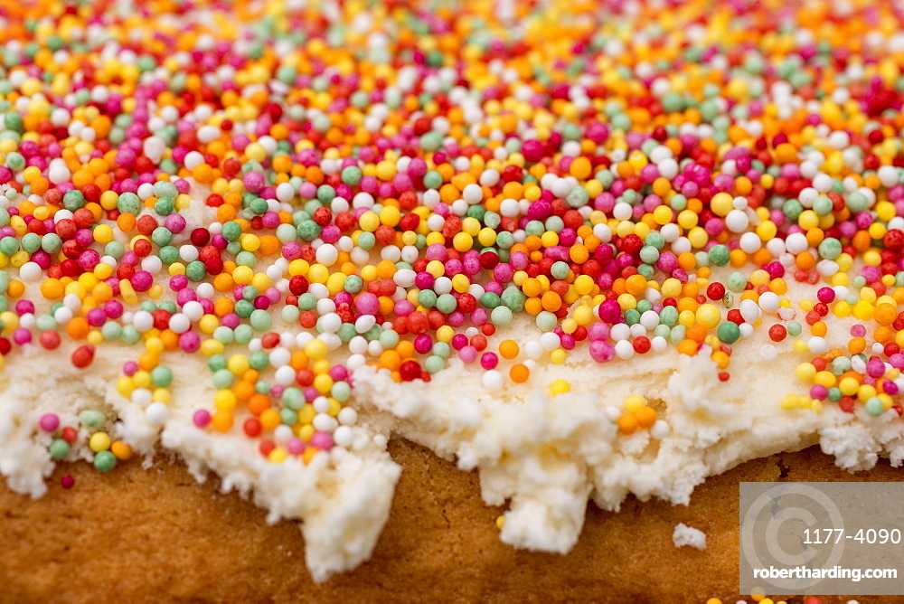 Close up multicolour sprinkles on cake frosting